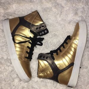 Supra gold and black high tops